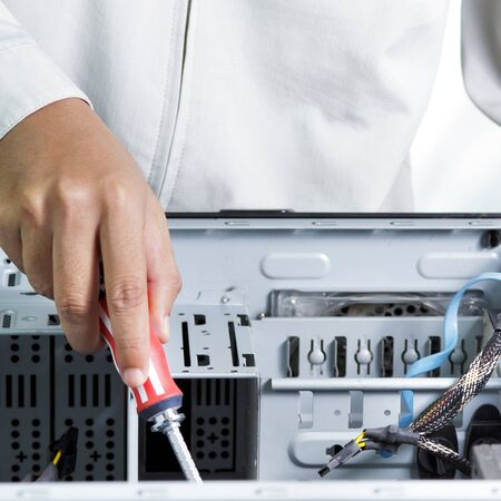 Technician repairing computer hardware photo