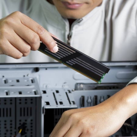 Technician repairing computer holding PC RAM  photo