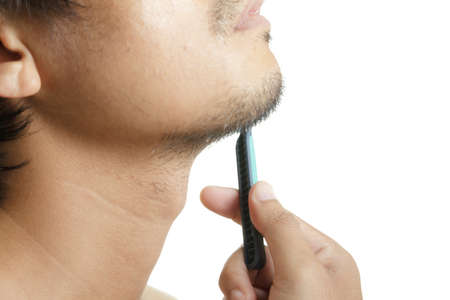 Close up of man shaving  photo