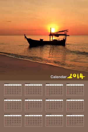 Silhouette of fishing boat at sunset, Calendar 2014 photo