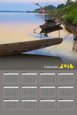 Fishing boats in the Mekong River at sunrise, Calendar 2014 photo