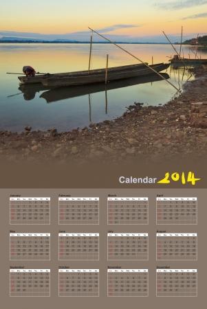 Fishing boats in the Mekong River, Pakse - Laos, Calendar 2014 photo
