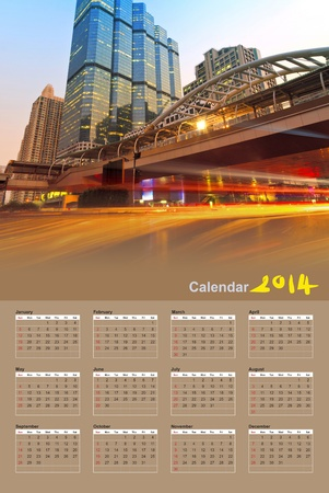 The light trails of the cars in the city on the modern building background in Bangkok Thailand, Calendar 2014 photo