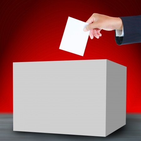 Hand with ballot and box photo