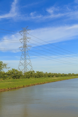Canal and high voltage poles Stock Photo - 20815403
