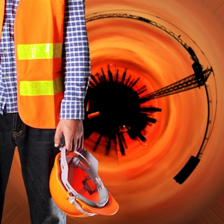 Construction worker with abstract construction background photo