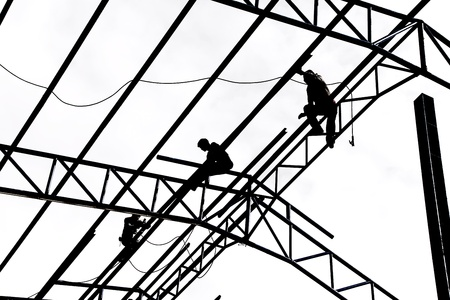 Silhouette of construction workers on white background photo