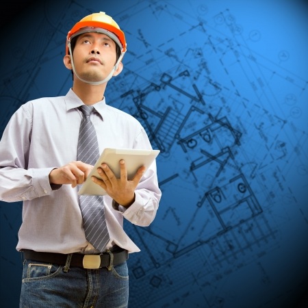 Engineers and architects using digital tablet with architectural drawing abstract background  photo