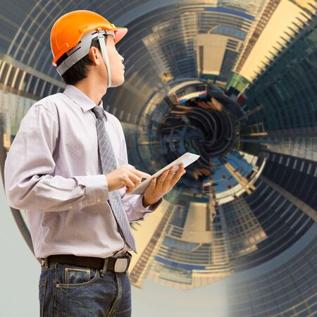 Engineers and architects using digital tablet with abstract city background photo