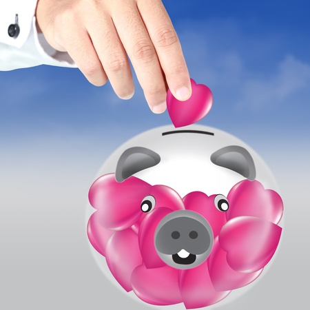 Piggy bank and heart photo