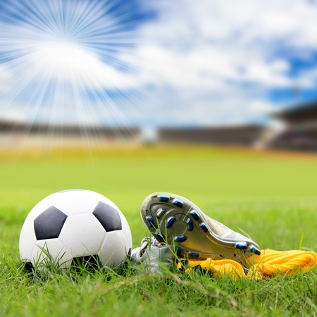 soccer shoes: Soccer ball and soccer shoes on the field Stock Photo