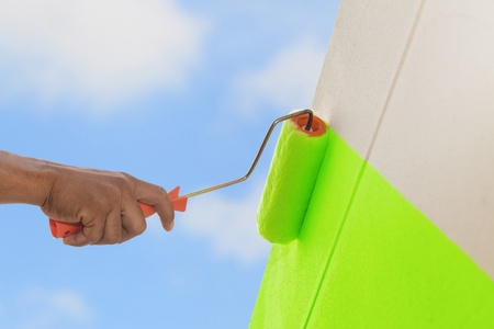 Green color painting wall with roller photo