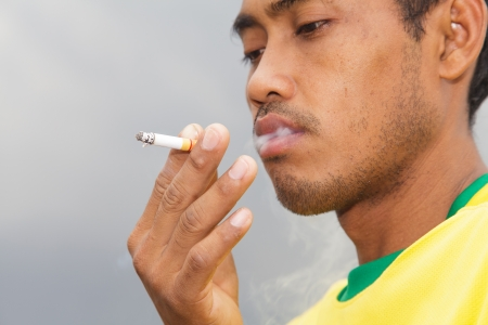 Man smoking a cigarette photo