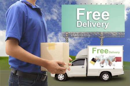 Delivery man with free delivery car and large outdoor billboard photo