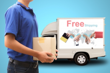 Delivery man with free shipping car Stock Photo