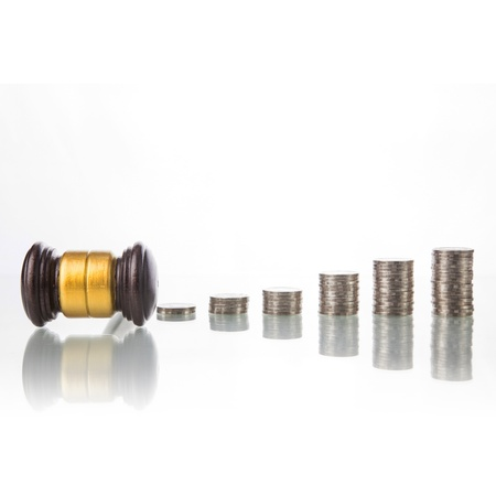 auction win: judges law gavel with coins Stock Photo
