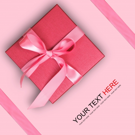 gift background: Red gift box on pink background