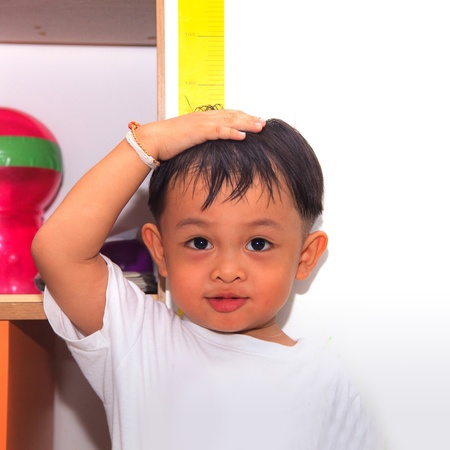 Little boy measuring his height Stock Photo - 22075048