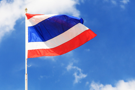 Thailand national flag on blue sky photo