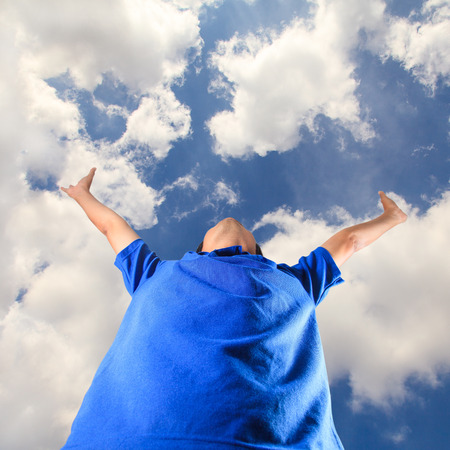 Happy young man, Freedom on blue sky photo