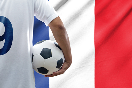 Soccer player with france flag photo