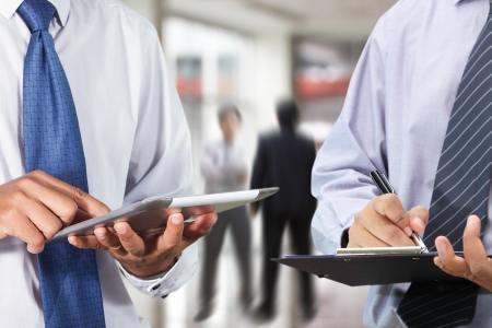 Businessman using tablet and signing a document in the office  photo
