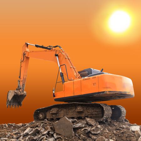 Excavator at sunset photo