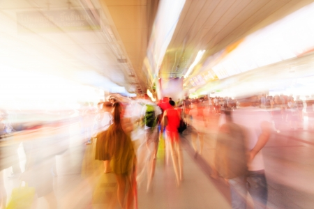 rushing hour: City people walking in sky train station in motion blur