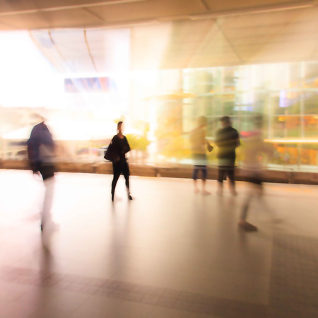 city people: City people walking in skytrain station in motion blur  Stock Photo