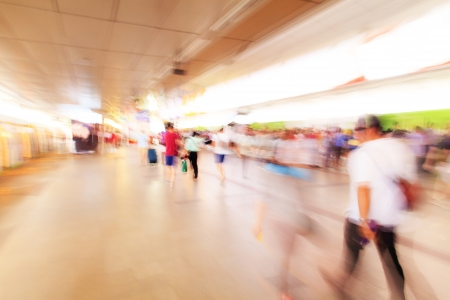 City people walking in sky train station in motion blur  photo