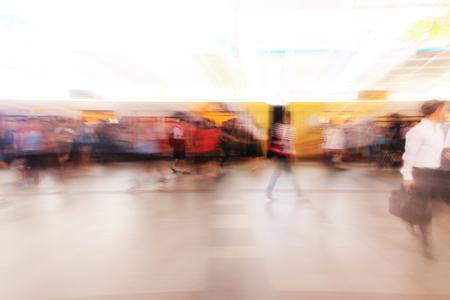 city people: City people walking in sky train station in motion blur