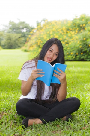 Woman reading a book in the park photo