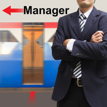 Manager on the sky train station, The concept of Moving forward photo