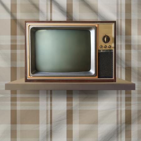 Vintage tv on shelf photo