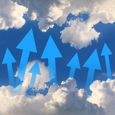 Arrows on the blue sky photo