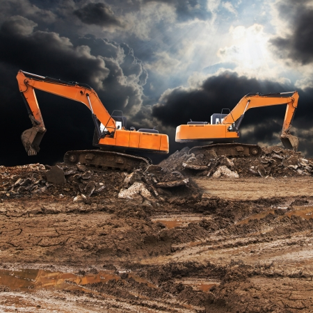 excavating machine: Excavator working at construction site  Stock Photo