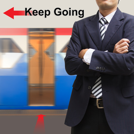 Businessman on the sky train station, The concept of Keep Going photo
