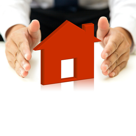 Red house and hands  Stock Photo