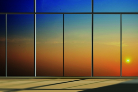 Windows in modern office building at sunrise photo