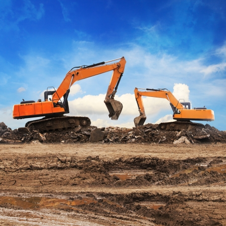 site: Excavator working at construction site  Stock Photo