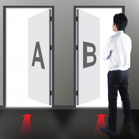 wicked problem: Businessman must choose A or B Stock Photo