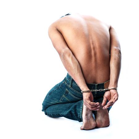strafgefangene: Gefangene in Handschellen gesperrt