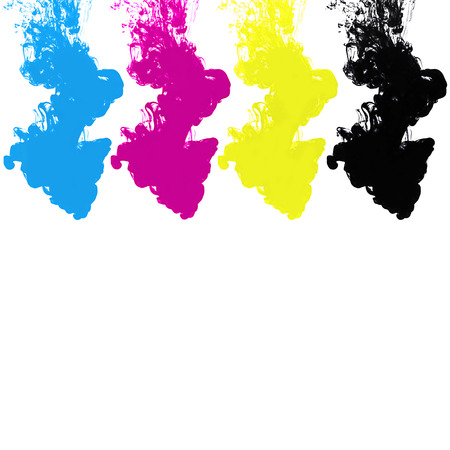 CMYK ink in water on white background  photo