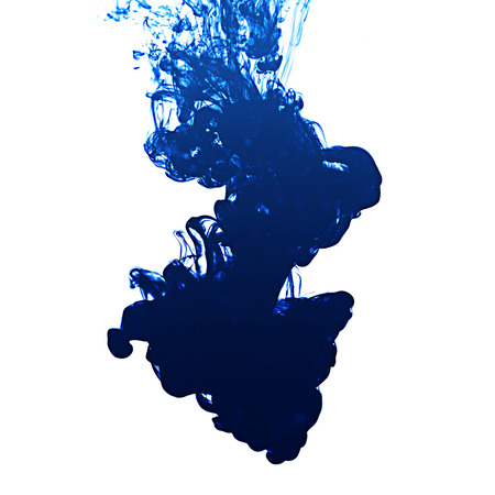 Ink in water on white background  photo