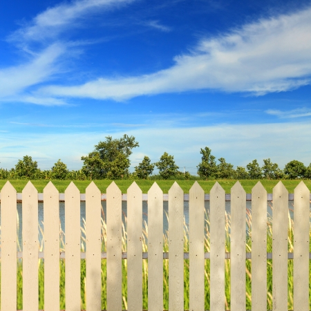 White fences with blue sky photo