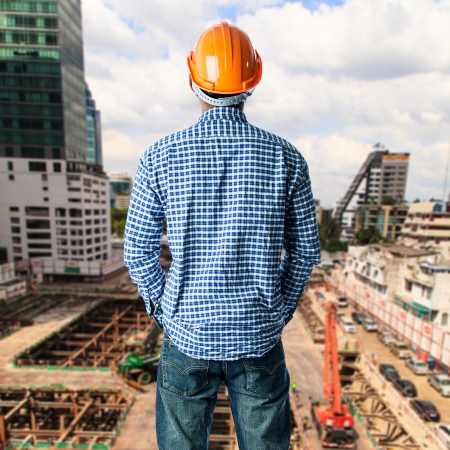 african business: Construction worker at construction site in blue sky