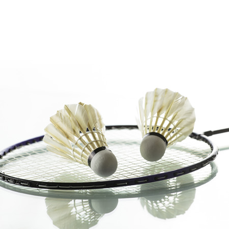 Badminton on white background photo