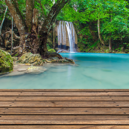Wooden floor with waterfalls background photo