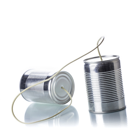 Tin cans telephone on white background photo