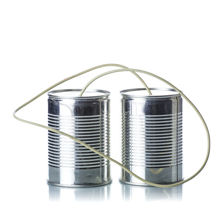 tin can phone: Tin cans telephone on white background Stock Photo
